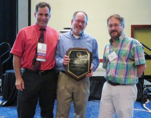 Dr. Theodore Klein (c) receiving the SIVB Fellow Award at the 2014 World Forum on Biology from John Finer (l) and Wayne Parrot (r)