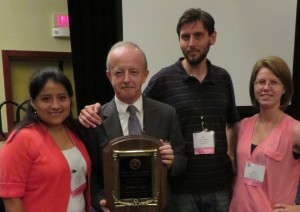 Michael Kane with members of his lab congratulate him on winning the Lifetime Achievement Award