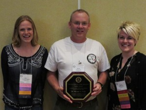 Kerri Neugebauer and Jessica Rupp presents Harold Trick with the 2015 Fellow Award